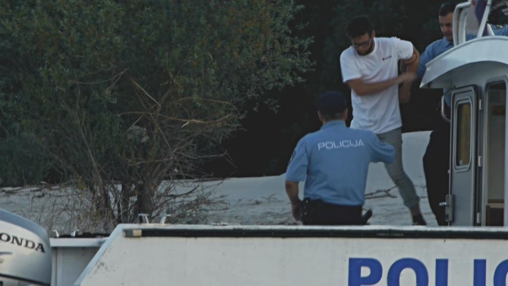 Author of the article dragged to the police boat.