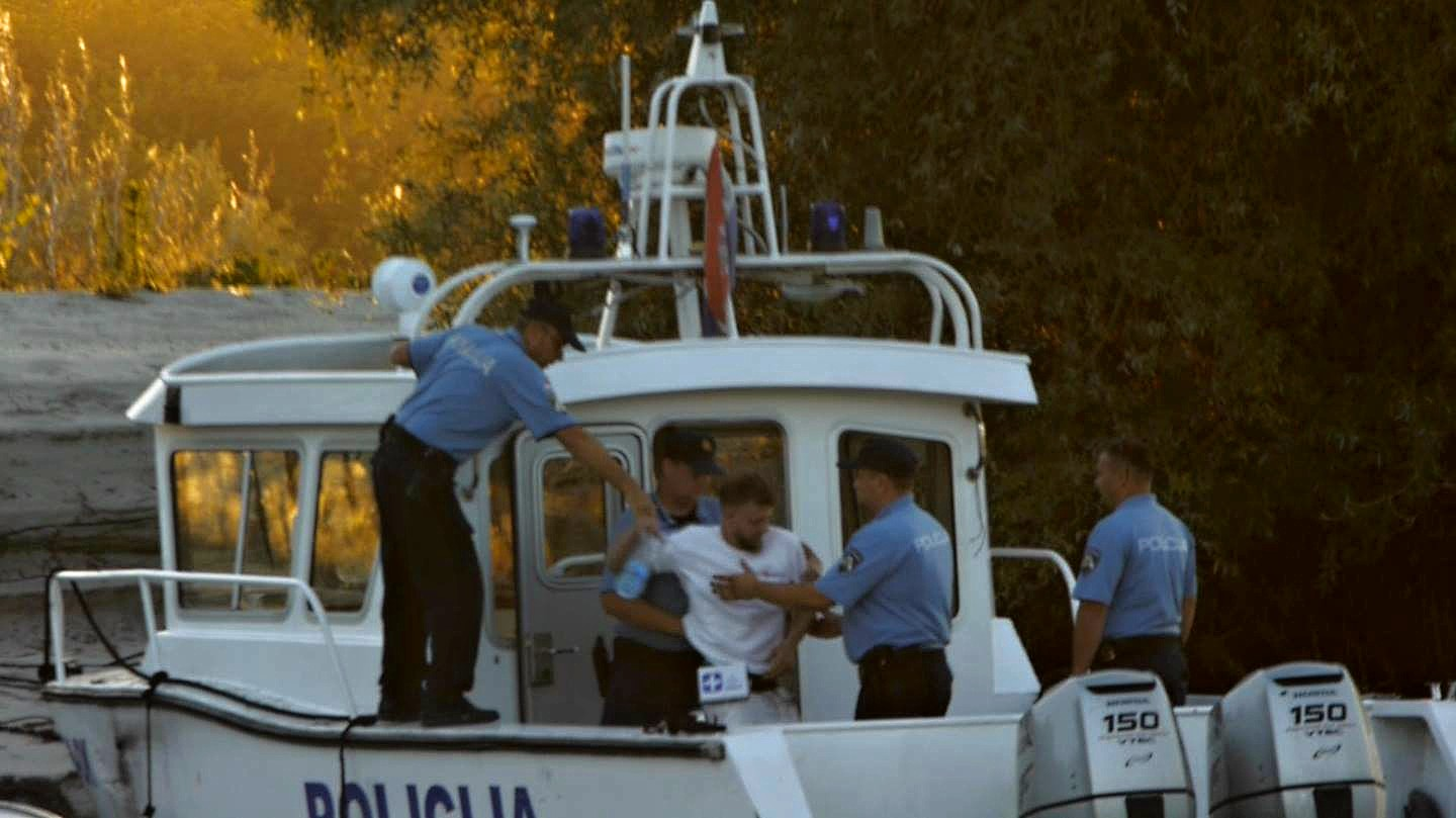 """Yoshi"", being brought onboard a Croatian police boat and sailed off from Liberland, to captivity in Croatia."